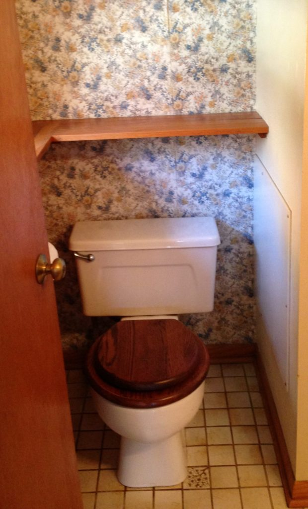 Before Picture of 70's Bathroom Toilet and Wallpaper