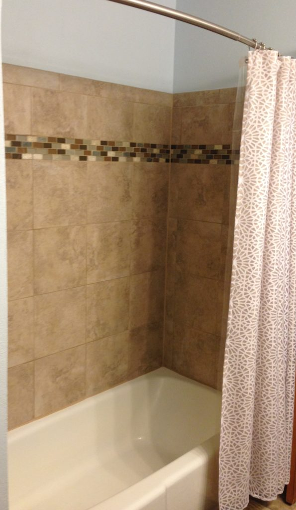 After Picture of a Clean Tub in Bathroom
