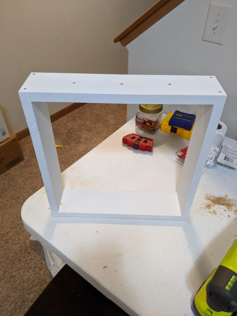 Screwing the boards together to form a square