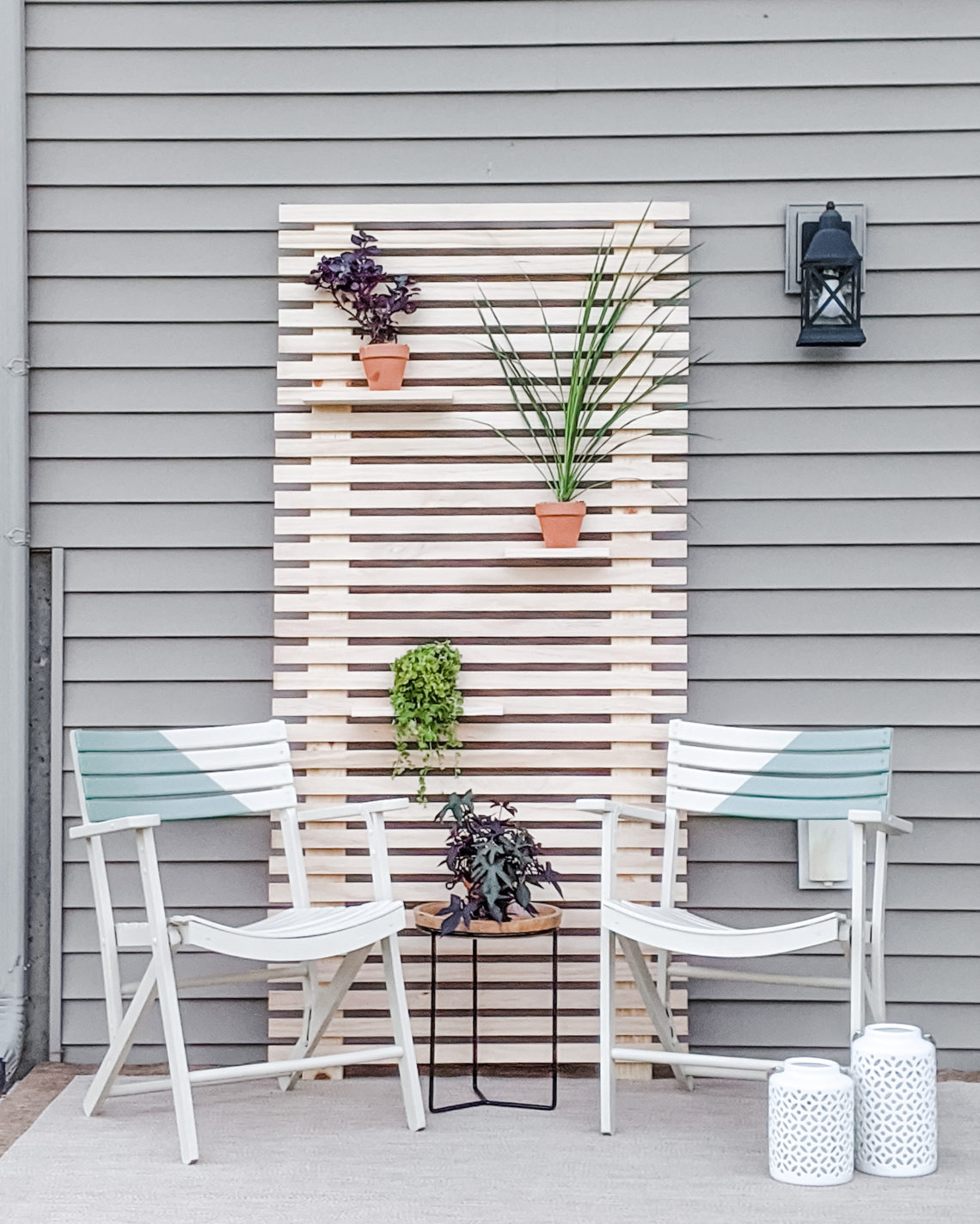 Outdoor Patio Makeover with Painted Chairs and Wood Slat Plant Wall