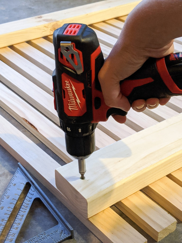 Attaching the slats to the 2x4s with a drill