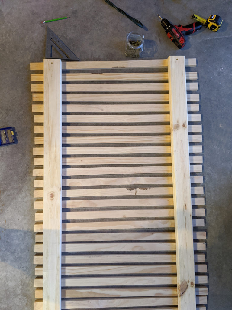 Laying out the boards for the wood slat planter wall