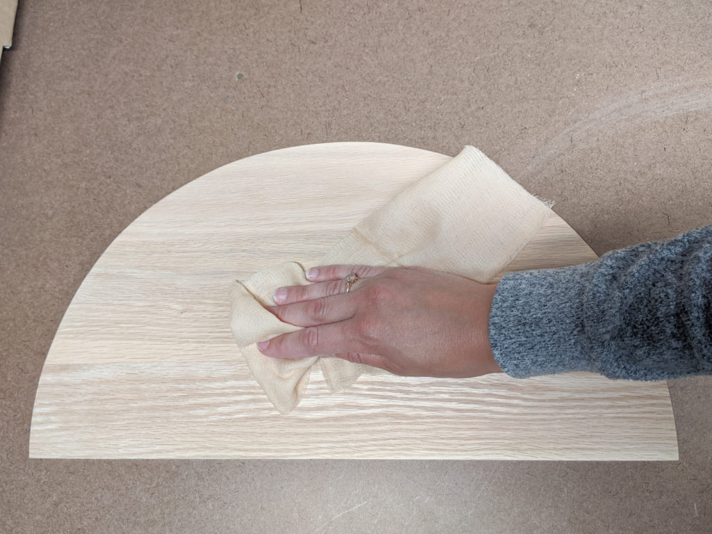 Wiping off wood with tack cloth