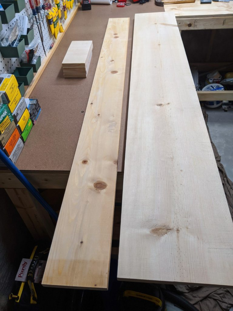 Pine boards cut into sections for bedside cubby