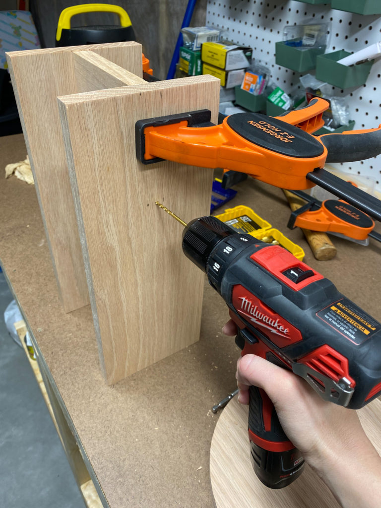 Assembling modern wood stool using clamps and a drill