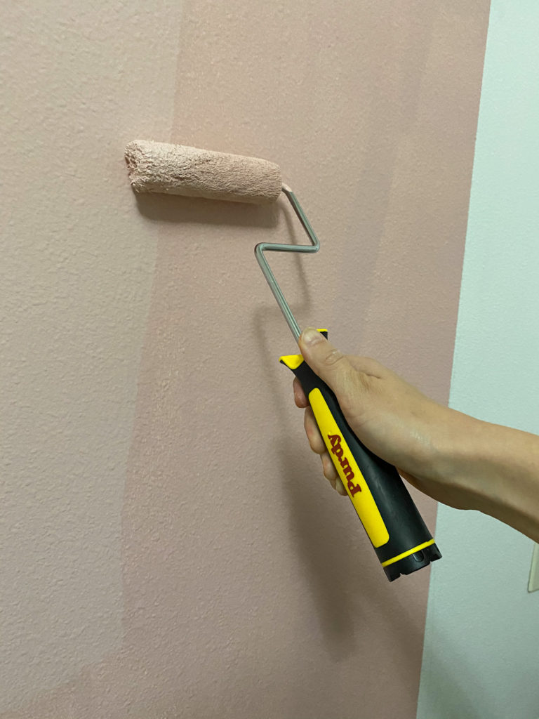 Putting on a second coat of paint using a Purdy mini roller