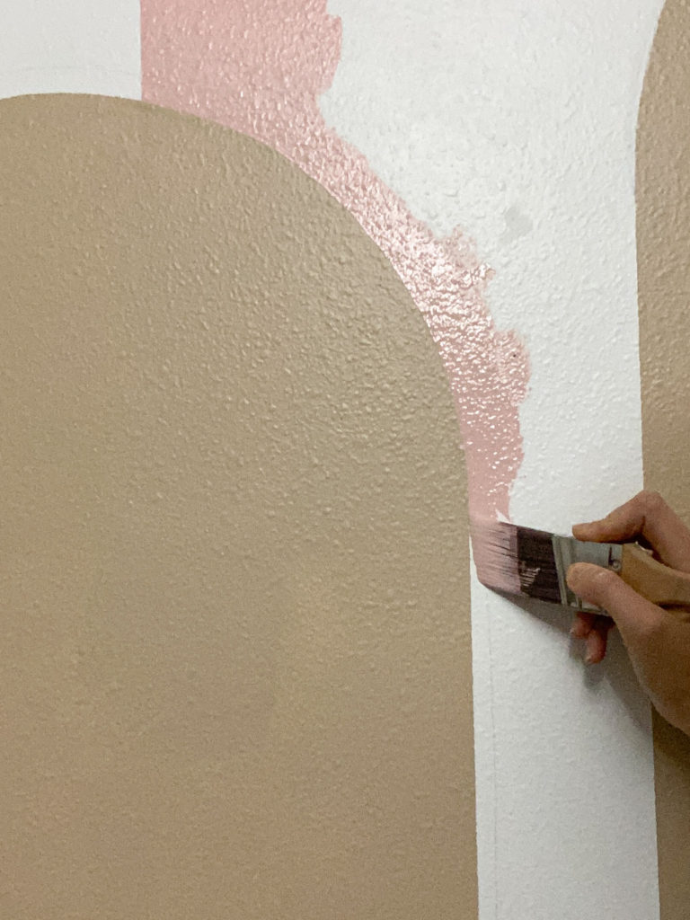 Painting clean lines in color blocking using a Purdy Clearcut Elite paint brush