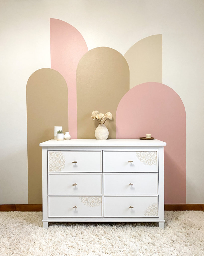 Finished color block arches wall in little girl's pink bedroom