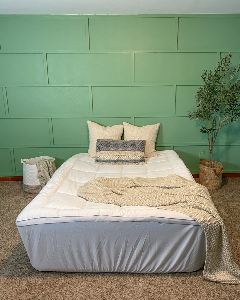 Mattress topper on air mattress in guest bedroom with modern accent wall