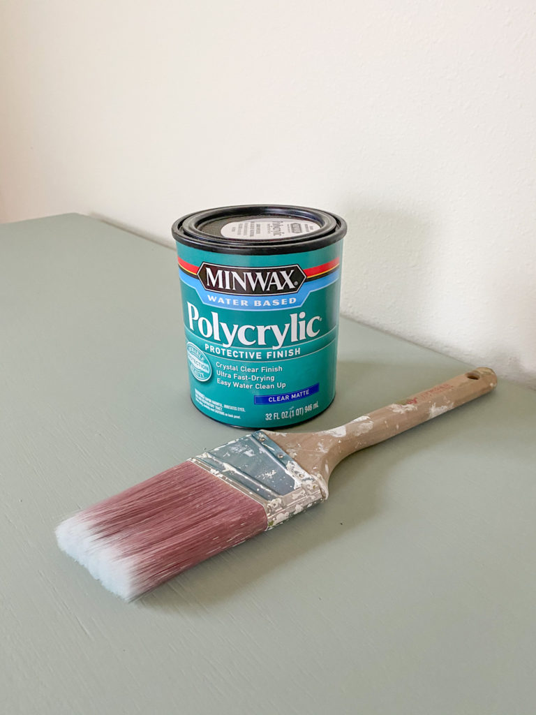 Applying polycrylic to the finished console table