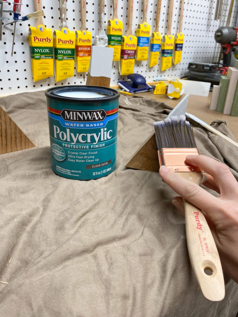 Applying polycrylic protective finish to mountain bookends