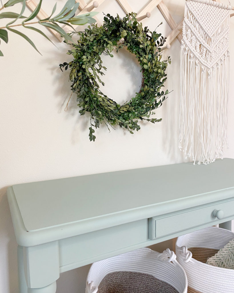 Close-up of refinished console table without any brush strokes