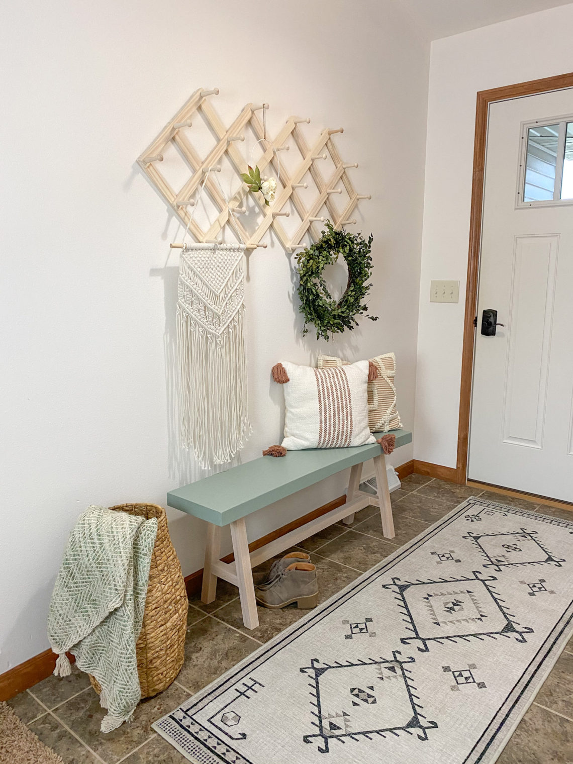 Coastal entryway with bench with Minwax Color of the Year Vintage Blue on it