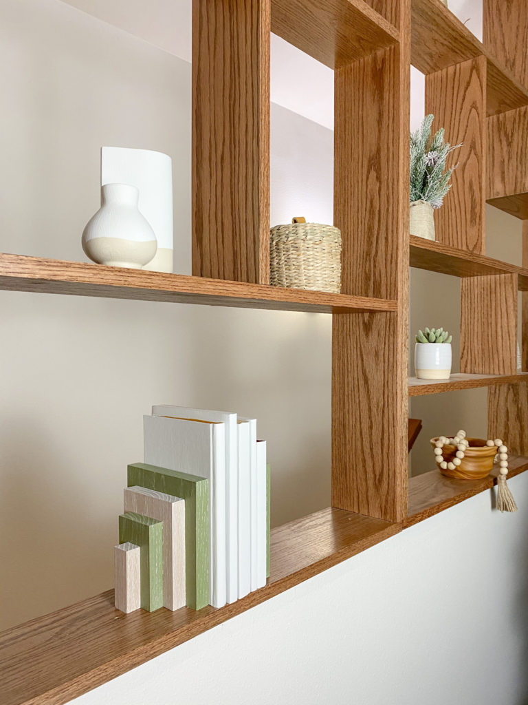Finished modern bookends on pony wall shelving