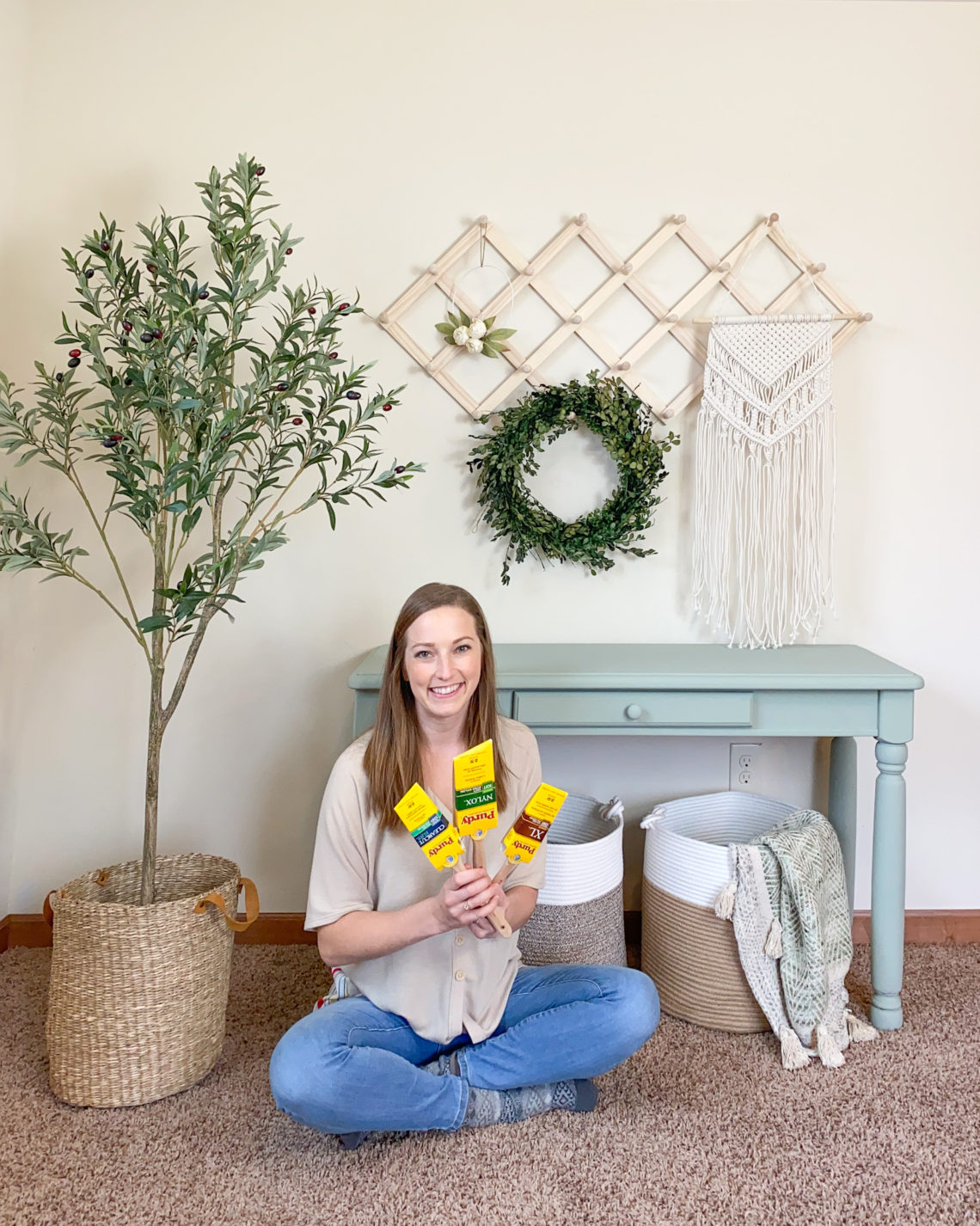 Refinished console table with me and my favorite paint brushes