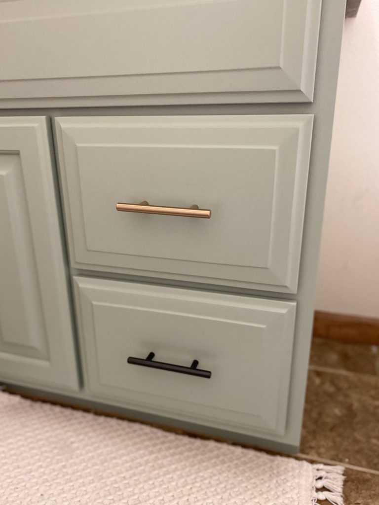 Beautifully painted bathroom cabinet without brush strokes in sage green