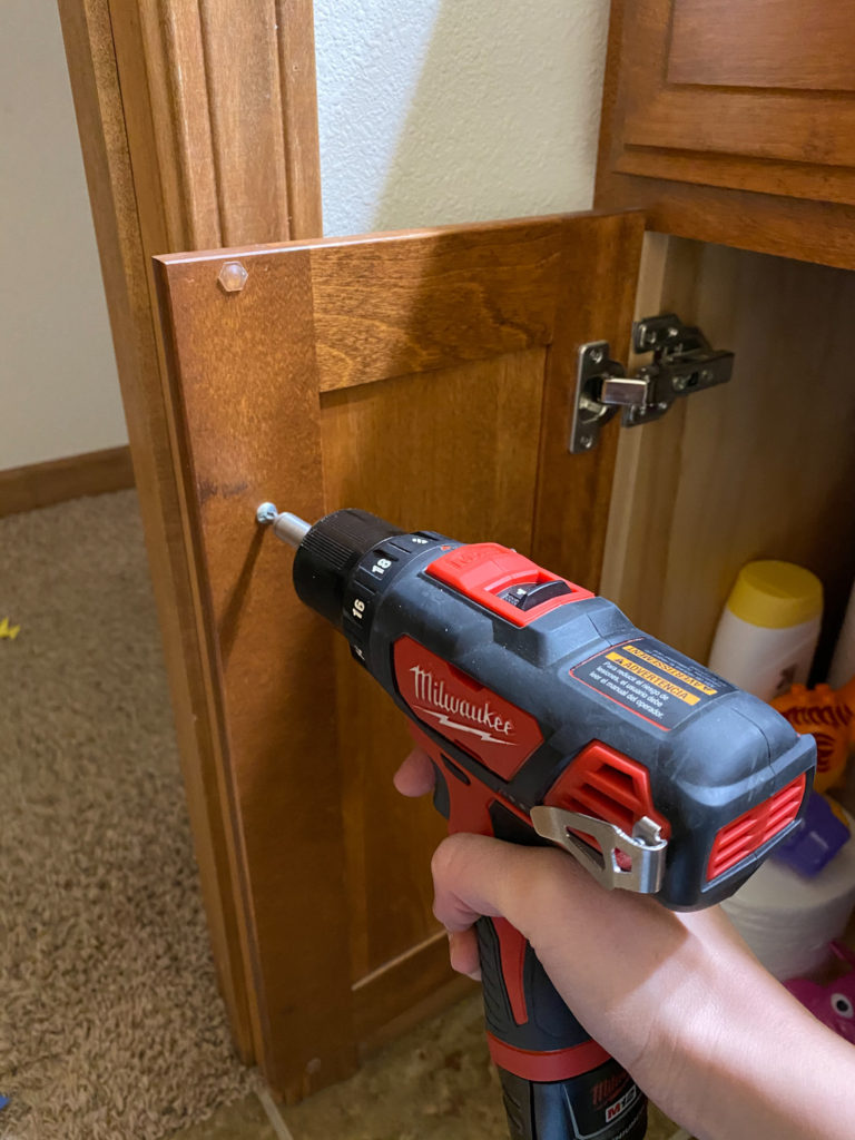 Removing hardware from bathroom vanity before painting