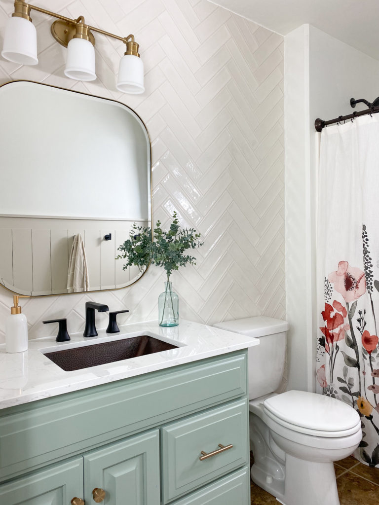 Beautiful white and green bathroom reveal with floral accents
