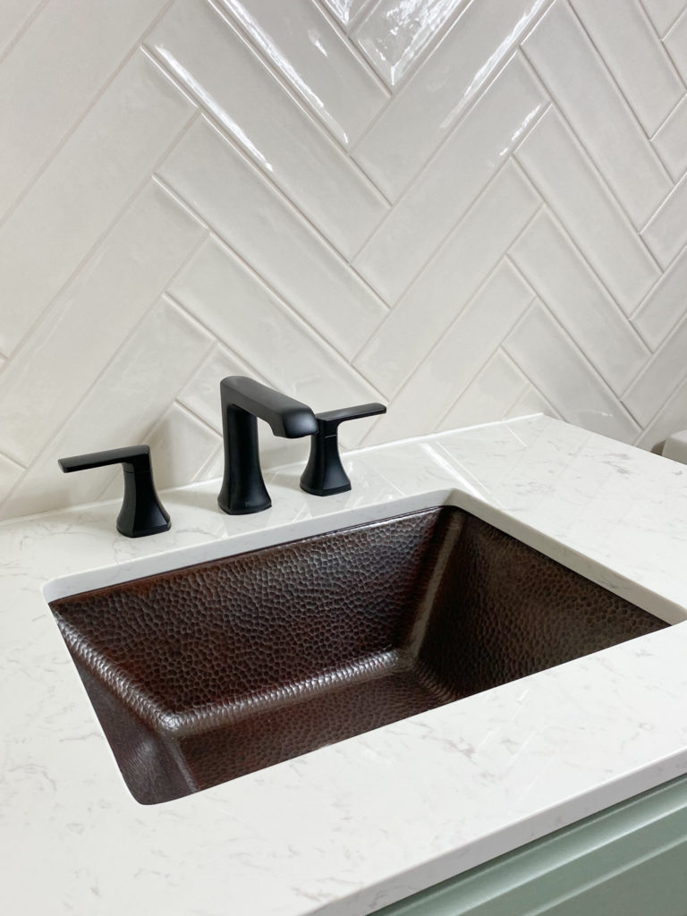 Installed bathroom sink, faucet and coutertop