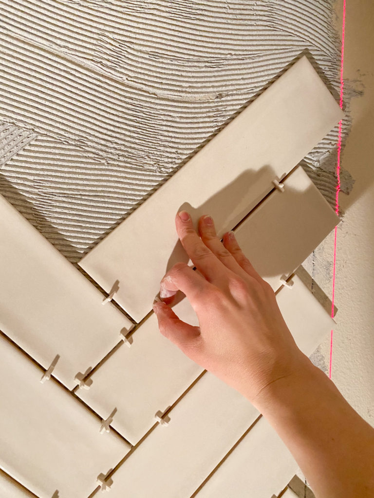 Placing tiles on wall with spacers