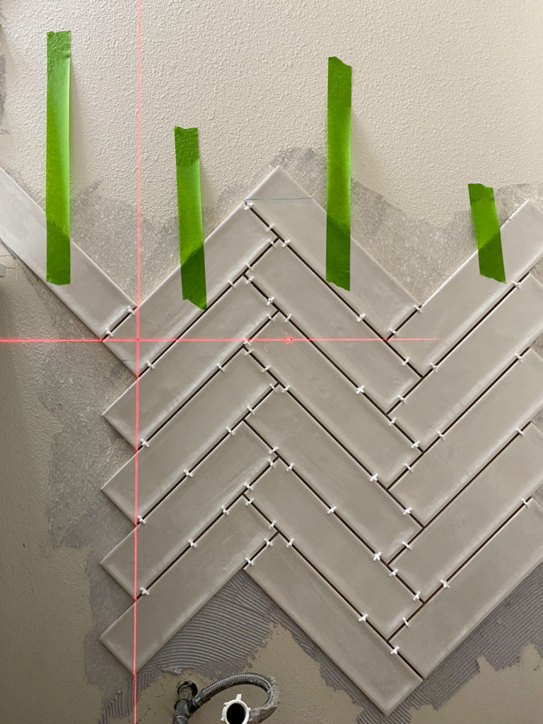 Using a laser level to get a perfect herringbone pattern with tile