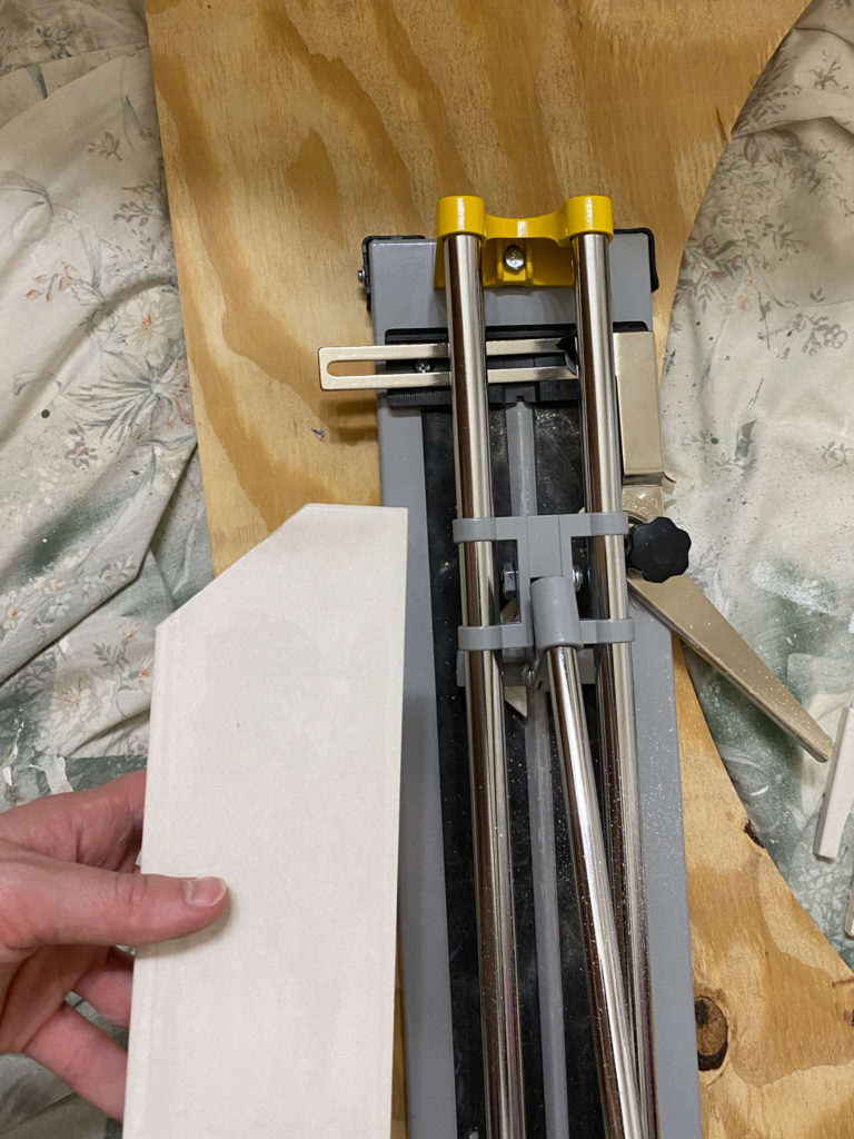 Cutting tiles with tile cutter