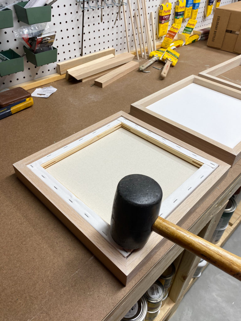 Tapping canvases into frames for modern wall art