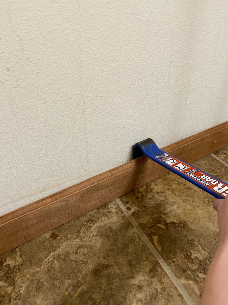 Removing trim with crowbar