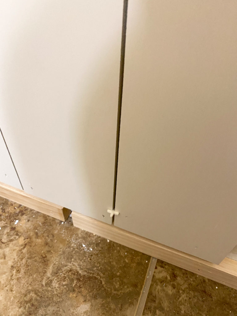 Using tile spacers to create a gap between boards to appear like shiplap