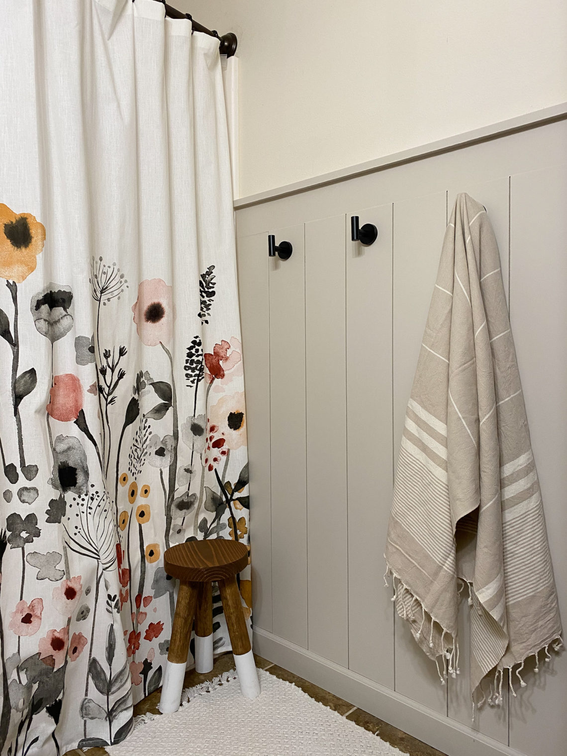 Finished Vertical Shiplap Wall in Bathroom with Floral Curtain