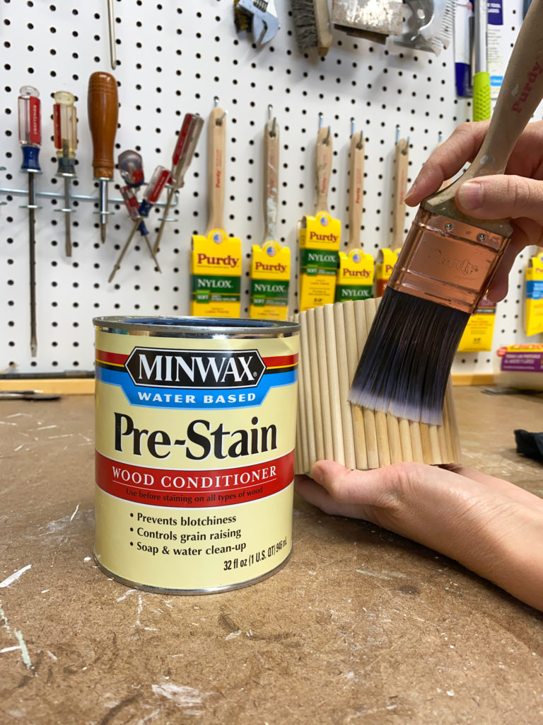 Applying prestain wood conditioner to dowel planters
