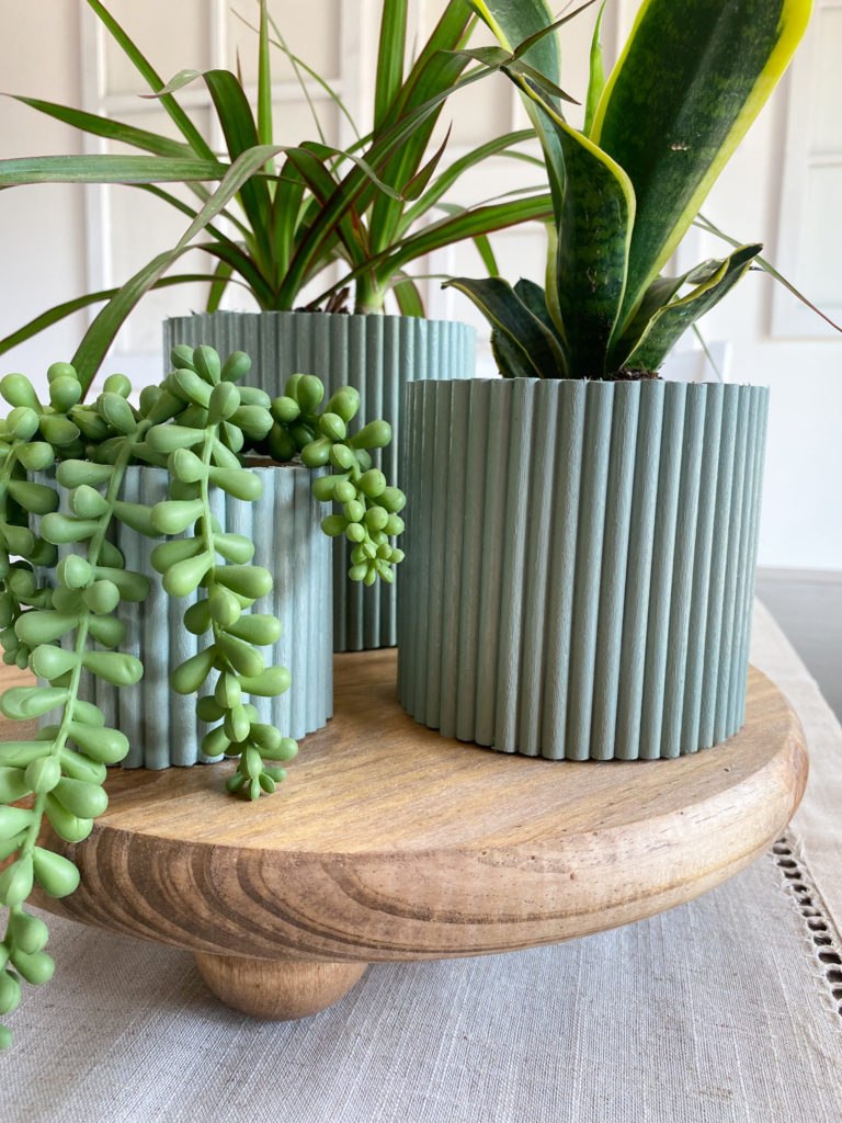 Up close view of plant riser and DIY dowel planters